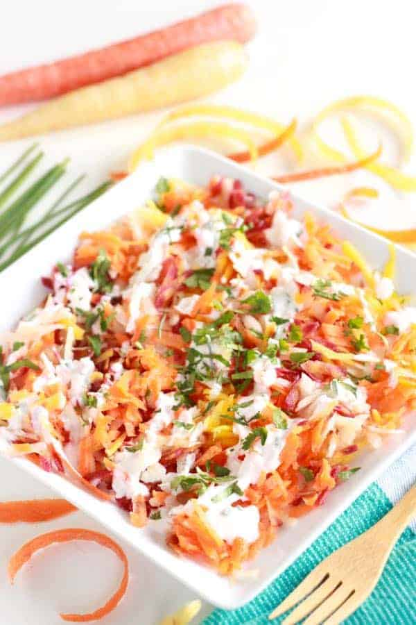 Raw grated carrot salad with fresh herbs and kefir ranch salad dressing