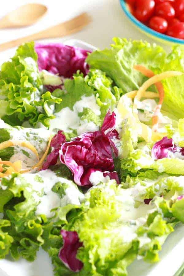 Salad greens dressed with kefir ranch dressing