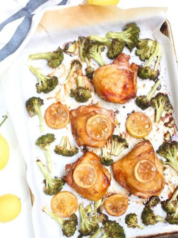 Chicken thighs on a sheet pan with broccoli