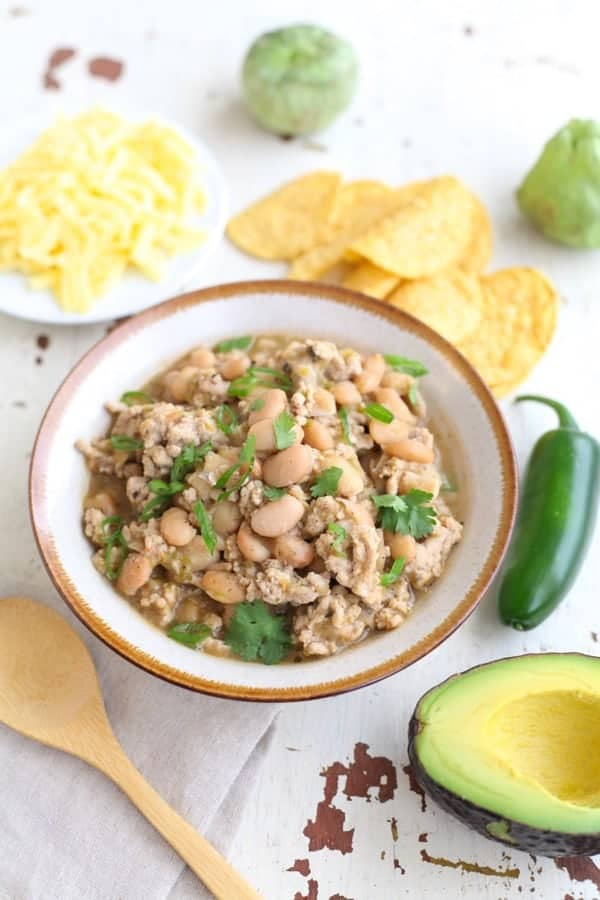White bean and turkey chili in a bowl garnished with cilantro