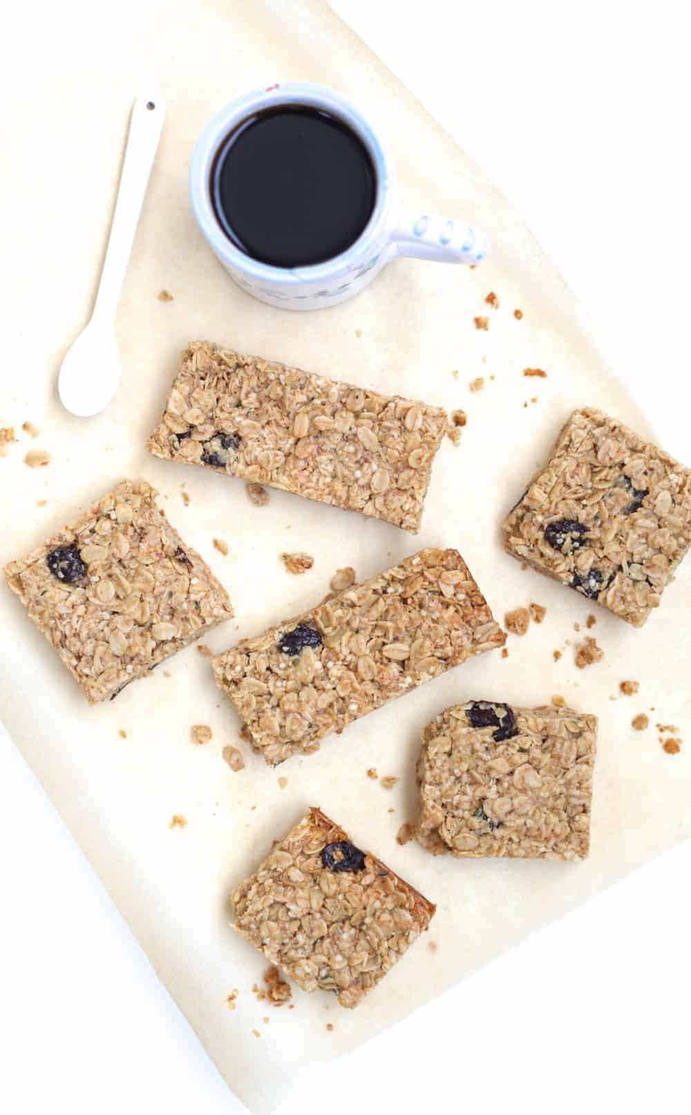 Overhead shot of tahini cherry granola bars and a cup of coffee