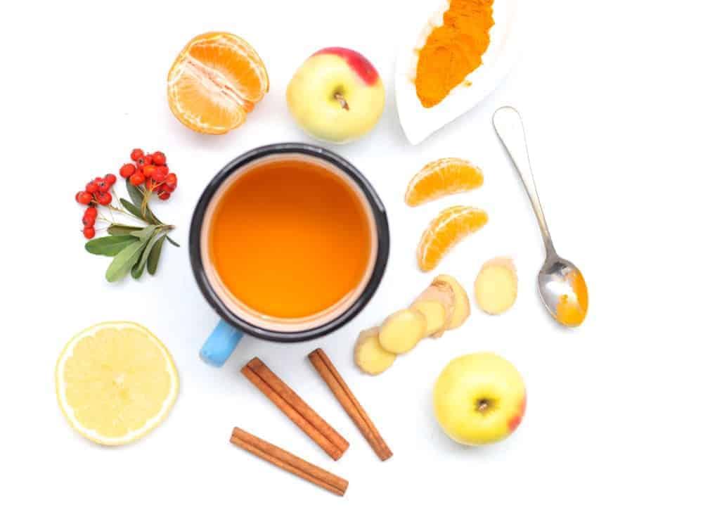 A mug of winter elixir made from ginger, cinnamon, turmeric, honey, apple cider vinegar and lemon