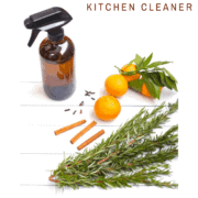 Glass spray bottle filled with natural kitchen cleaner