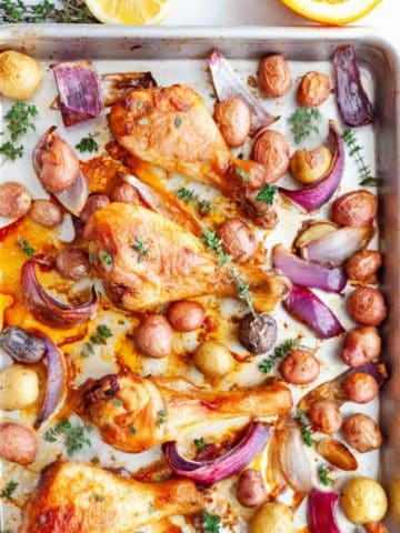 Sheet pan citrus and thyme chicken drumsticks with baby potatoes