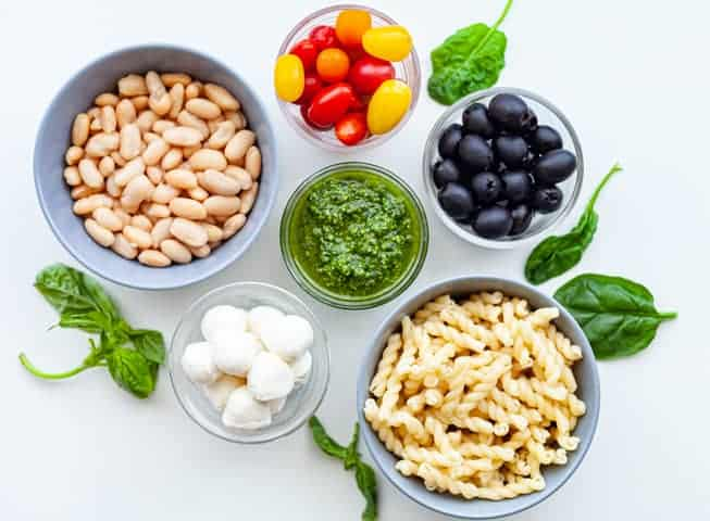 Ingredients for Spinach Pesto Pasta Salad with White Beans, Mozzarella and Tomatoes and Olives