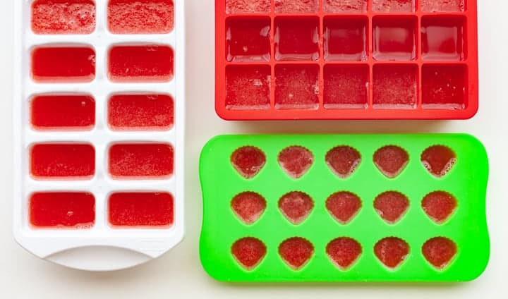 Ice cube trays filled with watermelon juice and coconut water