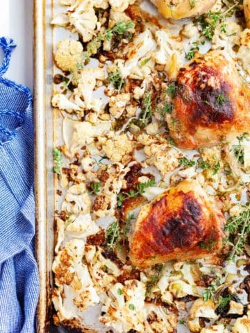 Sheet pan of roasted honey mustard chicken thighs and cauliflower