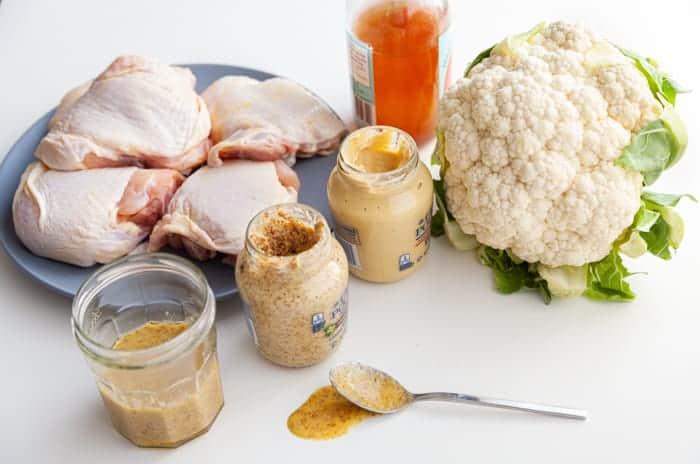 Ingredients for Sheet-Pan Honey Mustard Chicken and Cauliflower: mustard, apple cider vinegar, chicken thighs and cauliflower