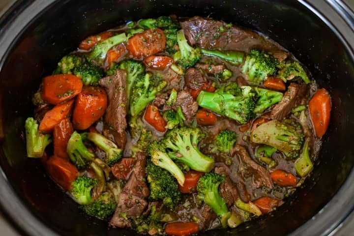 Crockpot Beef and Broccoli with carrots in a slow cooker