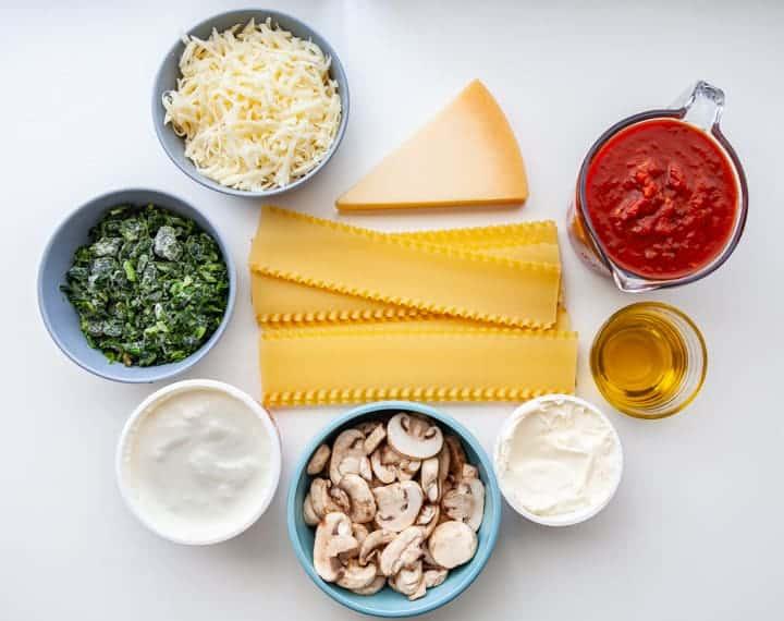Crockpot Lasagna Ingredients: ricotta, mushrooms, creme fraiche, olive oil, tomato sauce, parmesan, mozzarella frozen spinach