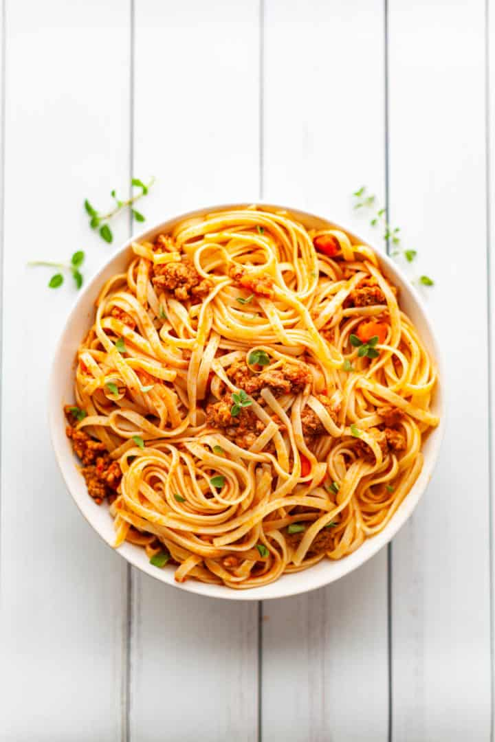 Bowl of fettuccine noodles and Instant Pot Bolognese sauce