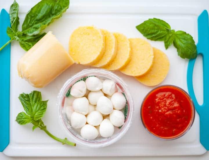 Ingredients for Turkey Meatballs Baked with Polenta and Mozzarella - small mozzarella balls, sliced polenta log, fresh basil, tomato sauce