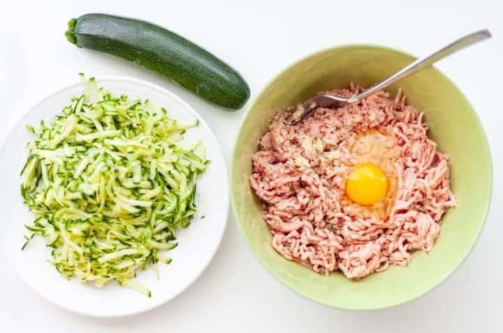 Ingredients for Baked Turkey Meatballs (with zucchini), raw turkey, egg, garlic, grated zucchini