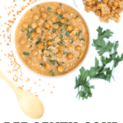 Bowl of red lentil soup topped with parmesan chickpeas