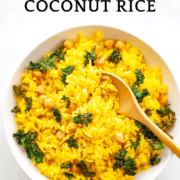 A bowl of yellow Instant Pot Turmeric Coconut Rice with kale and chickpeas