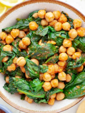 cooked chickpeas and spinach in a bowl