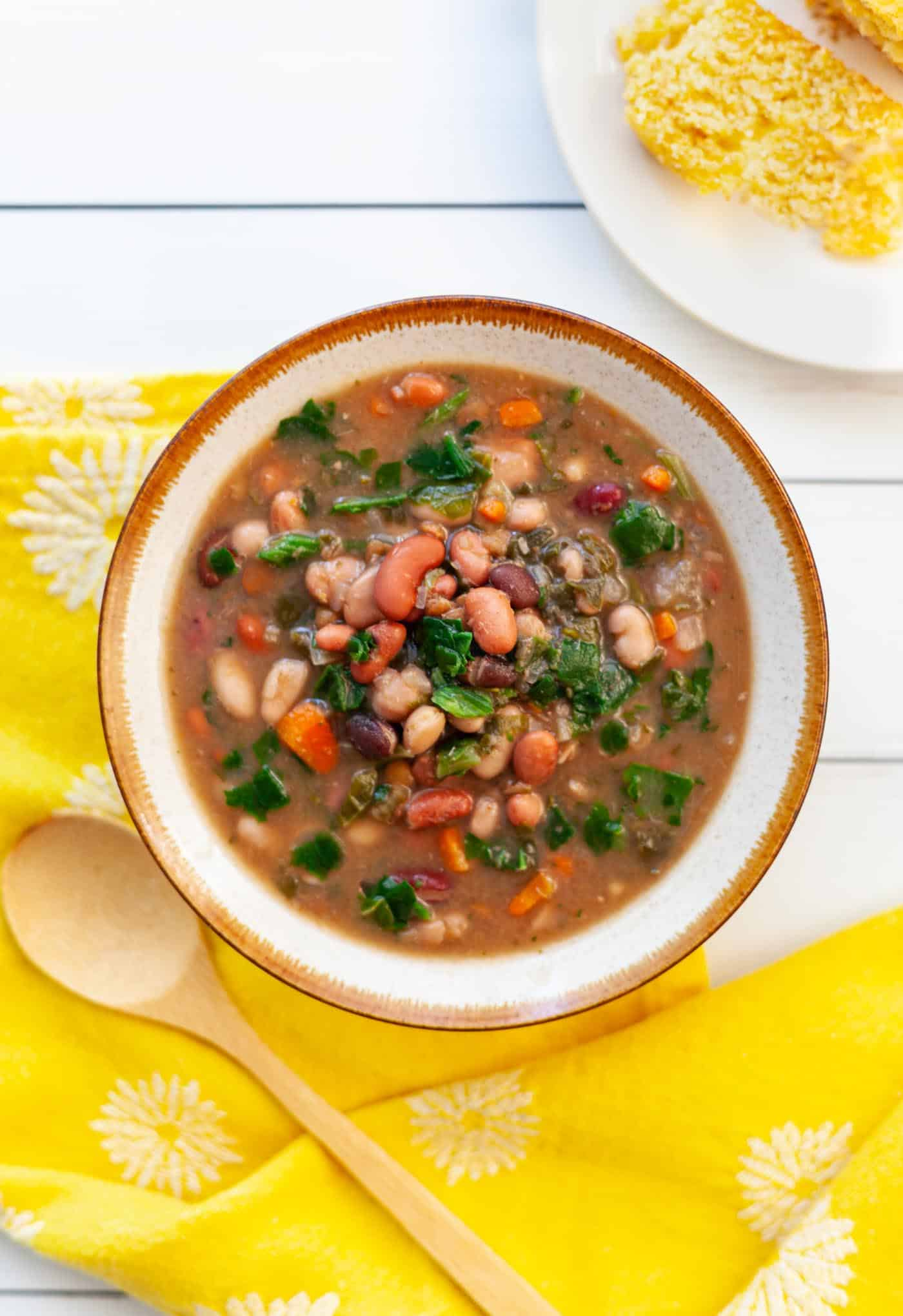 Bowl of 15 bean soup with carrots and spinach