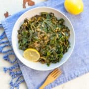 bowl of collard greens topped with chopped onion cooked in the instant pot