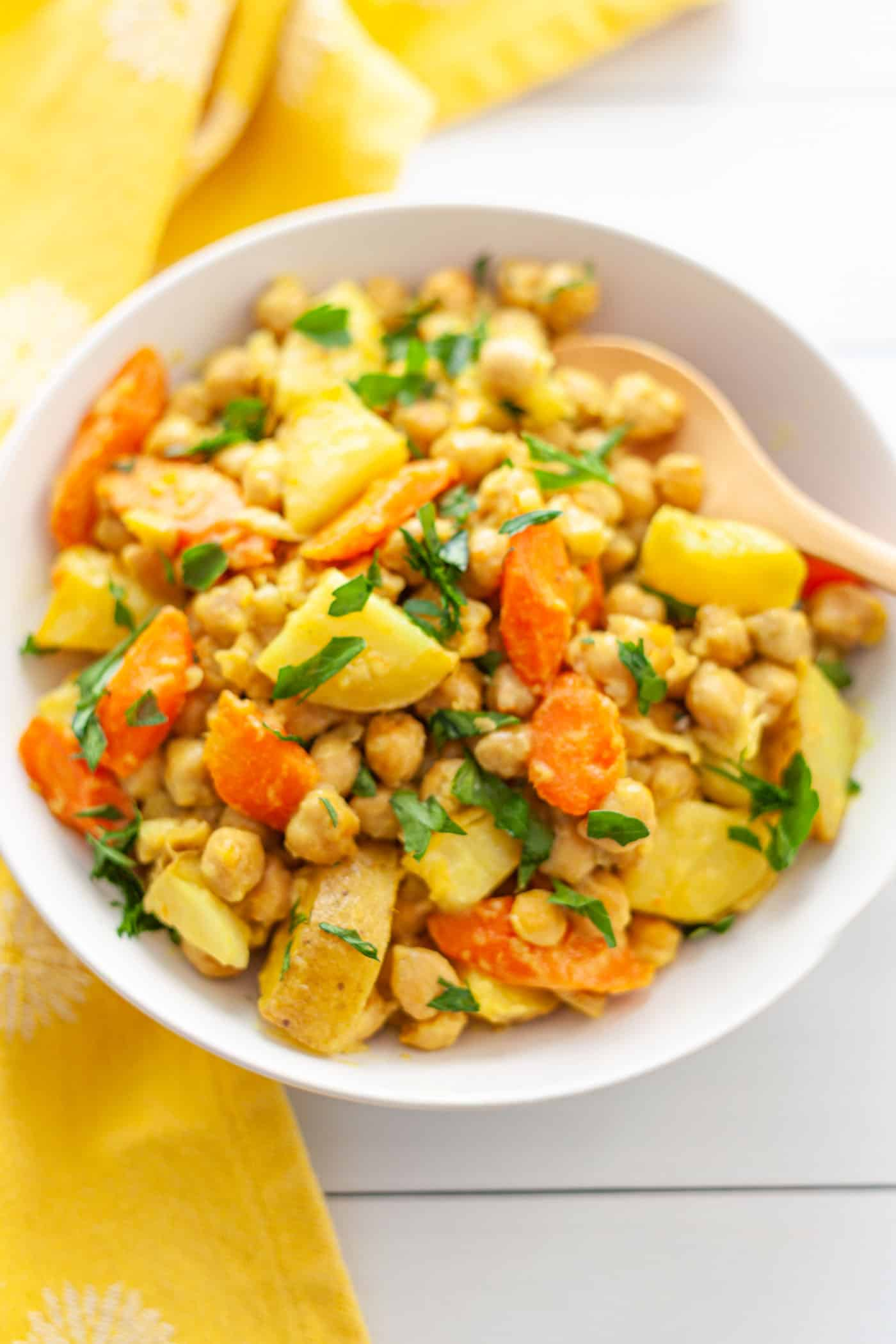 A bowl of chickpea stew with potatoes and carrots