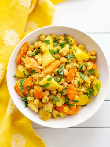 Bowl of chickpeas, potatoes and carrots cooked in coconut milk