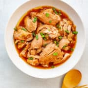 A bowl of Filipino chicken adobo made with boneless, skinless chicken thighs