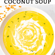 a bowl of creamy, pureed red lentil soup with coconut milk