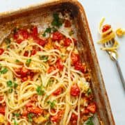 linguine in a pan with tomatoes and cheese