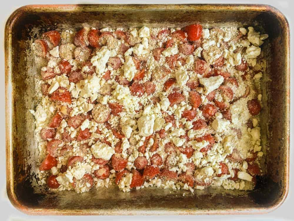 baking pan with tomatoes and cheese