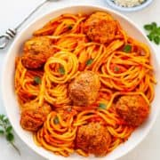 bowl of spaghetti and meatballs in red sauce