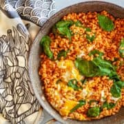saute pan with barley, spinach and eggs