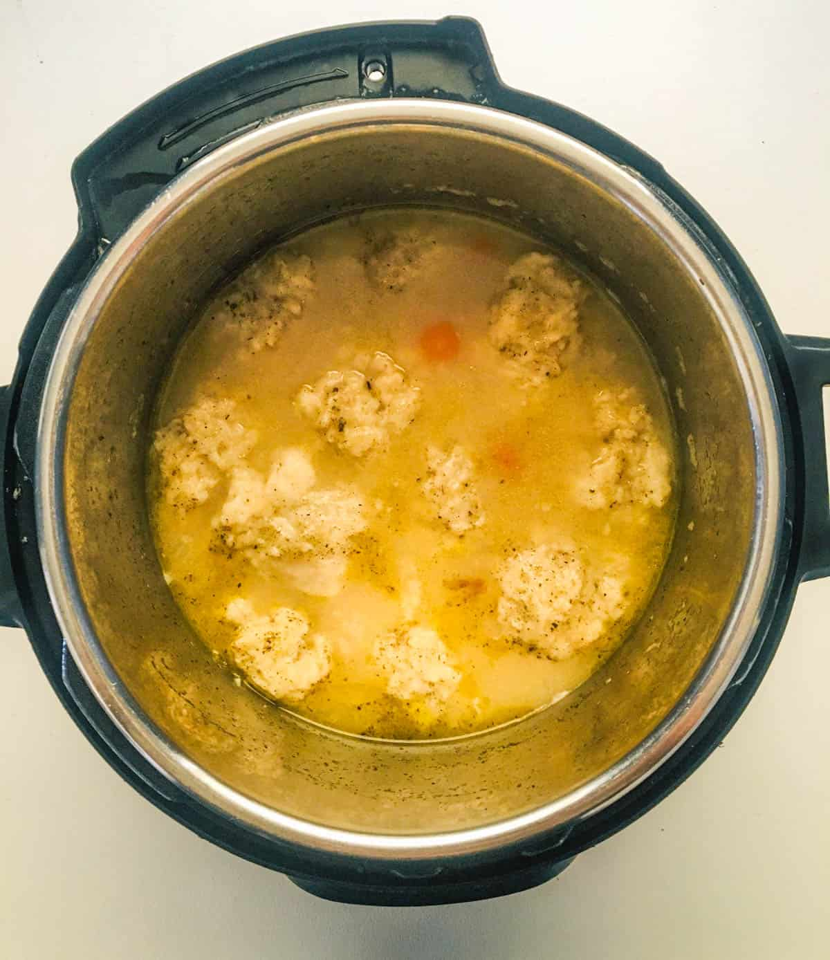 instant pot filled with cooked chicken and dumplings