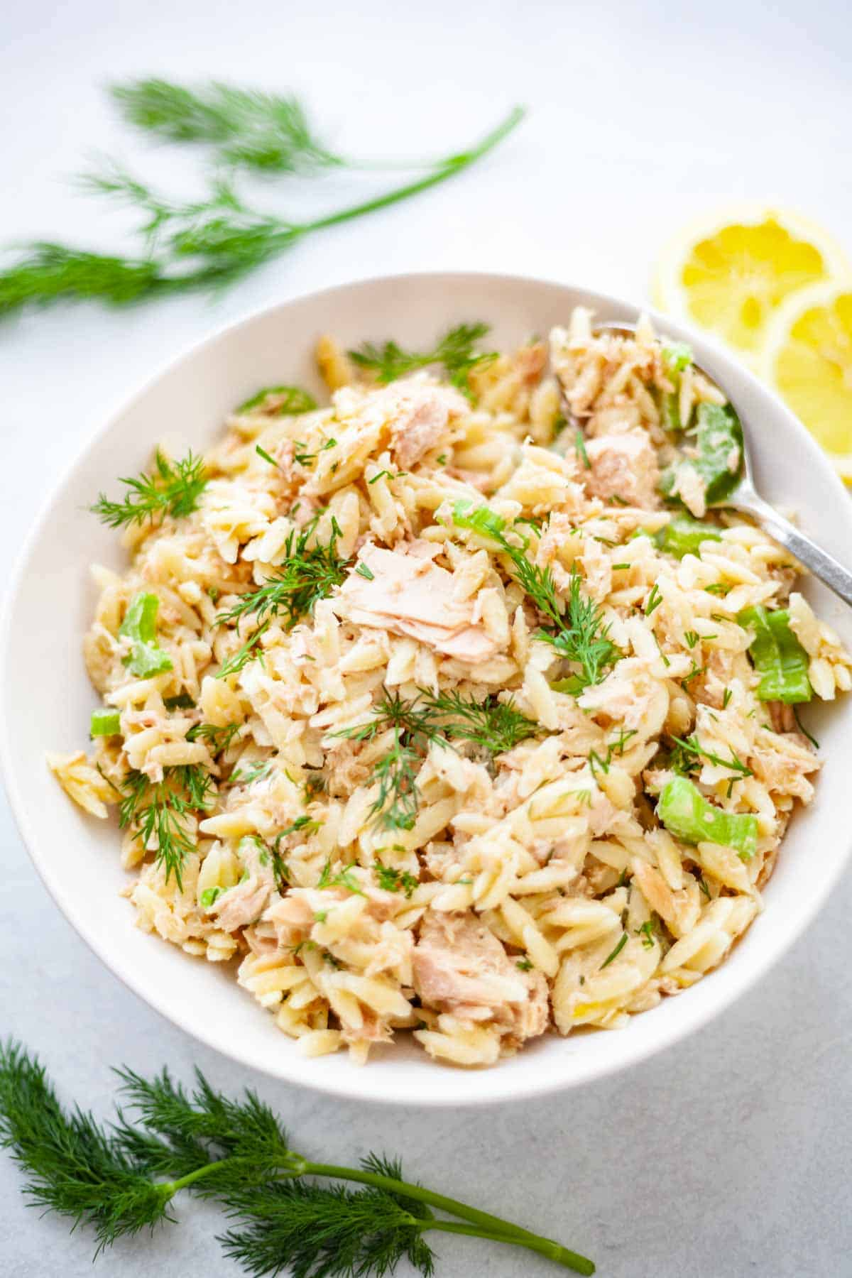 a bow of orzo and canned tuna with dill