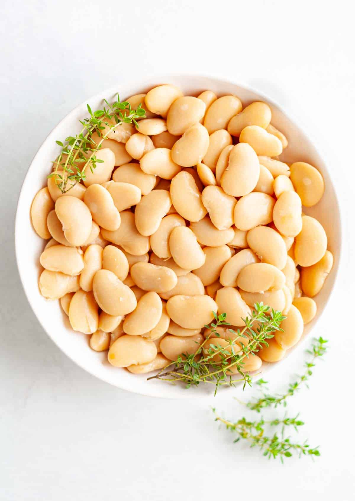 white bowl of canned butter beans