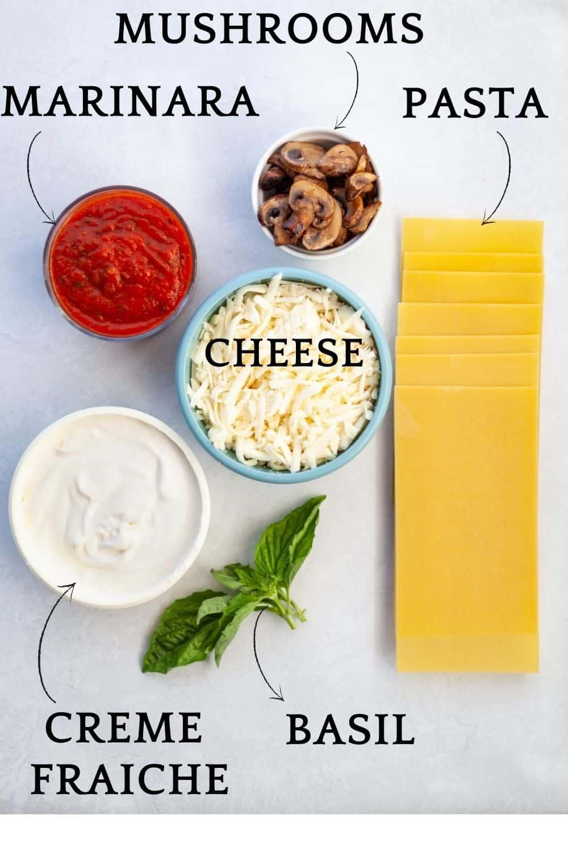 lasagna ingredients: creme fraiche, basil, marinara, pasta, creme fraiche, mushrooms and grated cheese