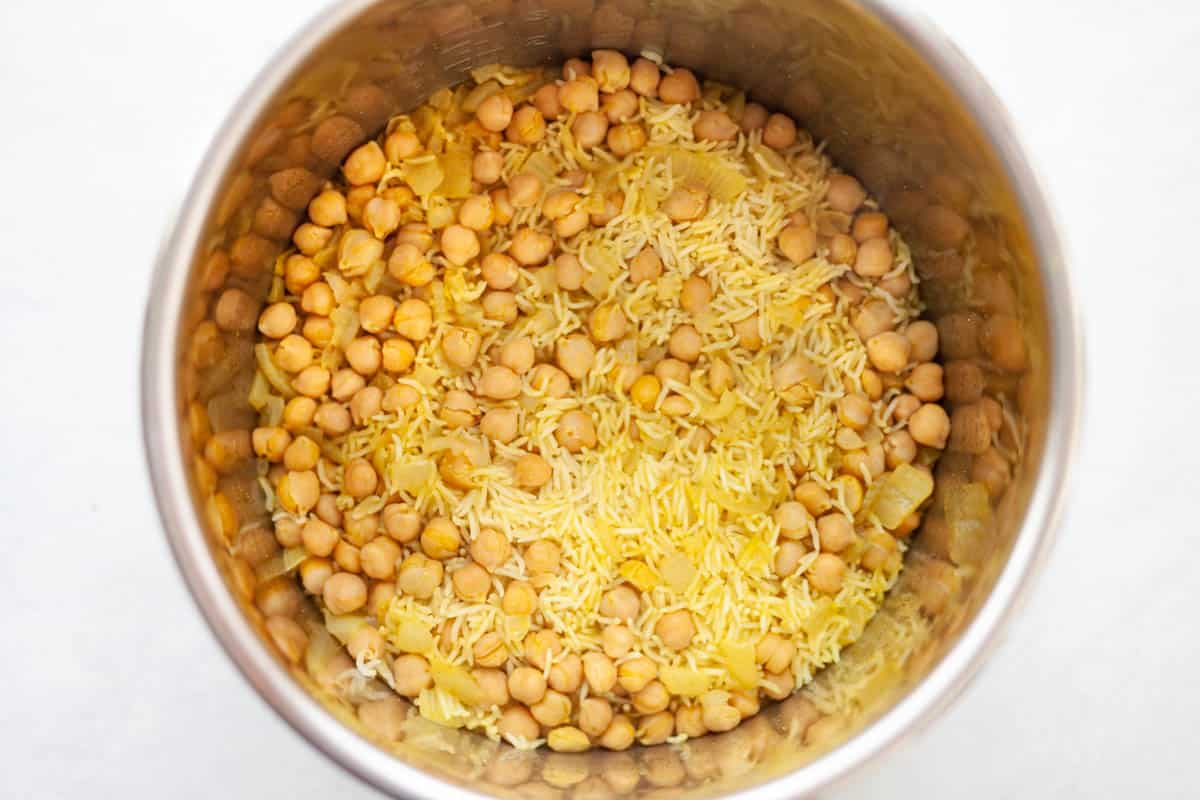 pressure cooker insert filled with cooked white rice and chickpeas