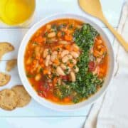 aa bowl of Instant Pot White Bean, Cabbage & Tomato Soup