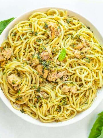 bowl of spaghetti with canned tuna and pesto