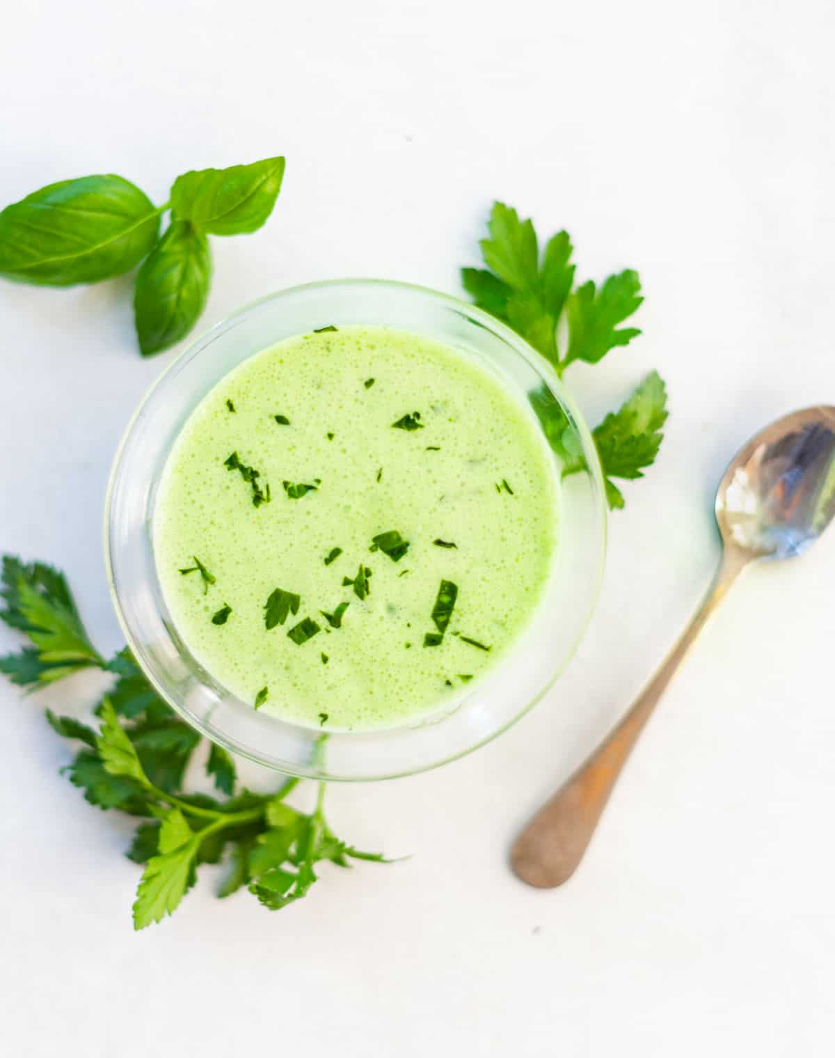 small bowl of green goddess salad dressing flecked with herbs