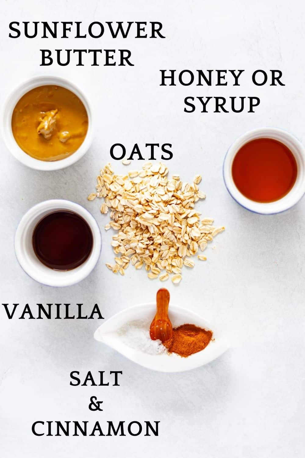 labeled ingredients for granola bars: sunflower butter, oats, honey or syrup, vanilla, salt and cinnamon