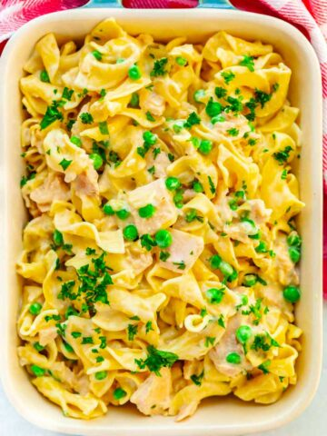 casserole dish of egg noodles, tuna and peas