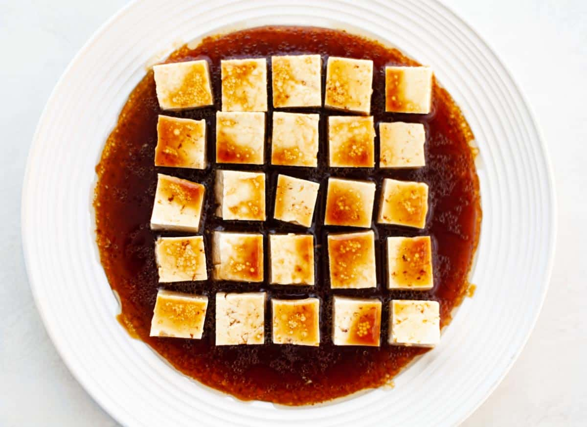 tofu marinating in soy sauce, balsamic vinegar, maple syrup and oil