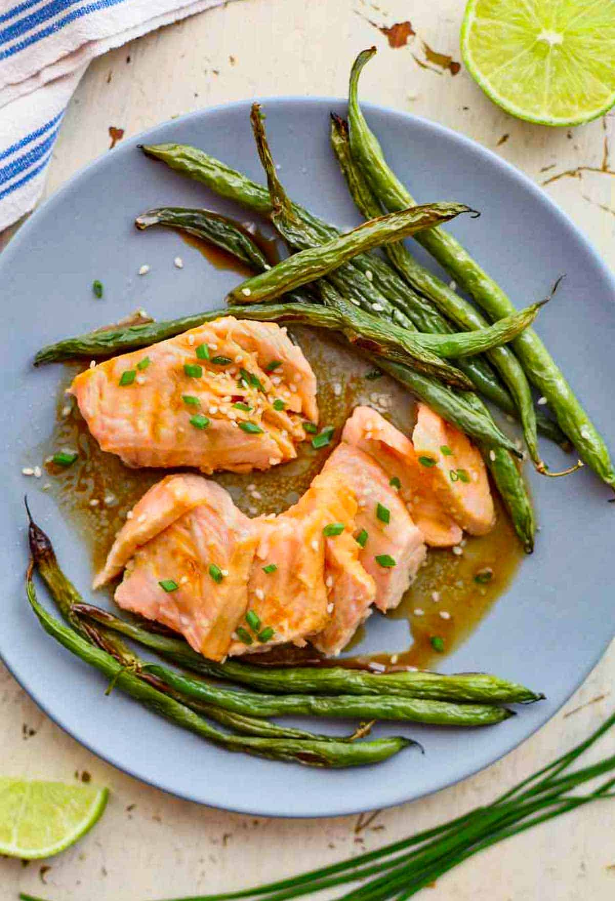 a plate of salmon and green beans