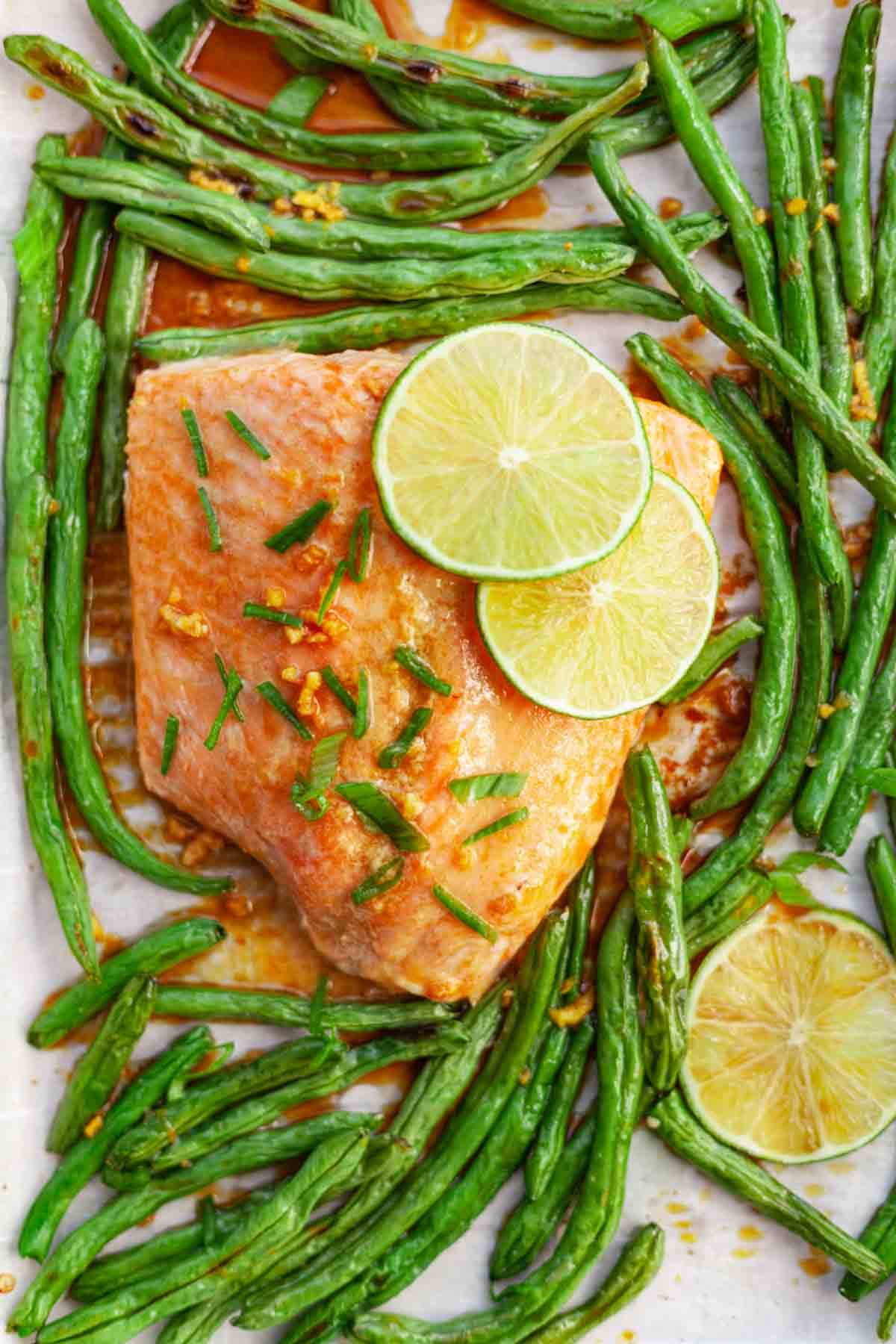 cooked salmon and green beans on a sheet-pan