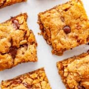 close-up of squares of almond butter bar squares with chocolate chips