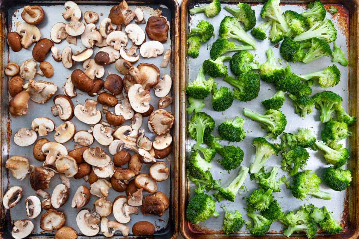 sheet-pans of raw mushrooms and broccoli florets