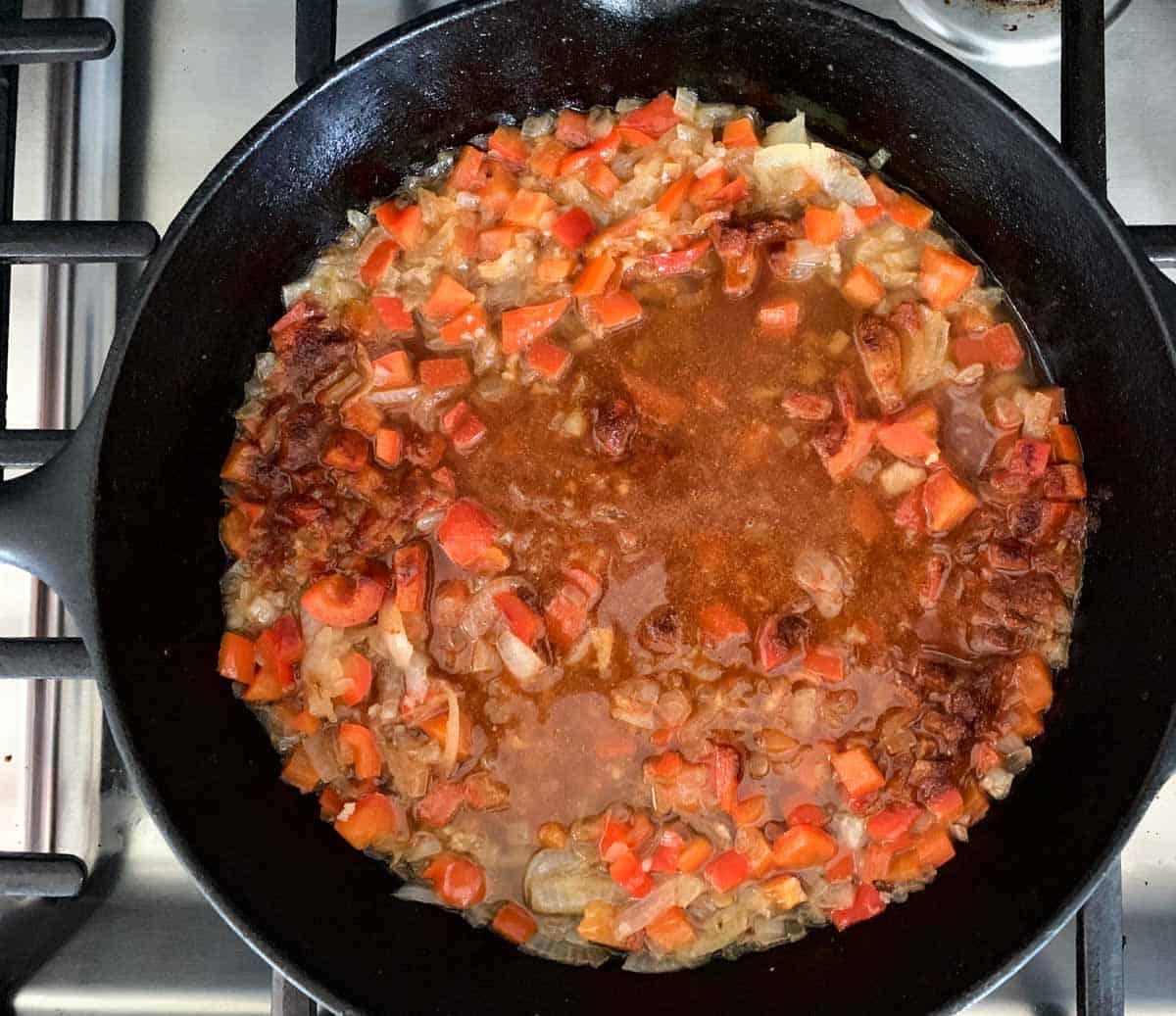 step 2: add chicken broth, paprika and salt