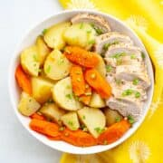 bowl of sliced chicken breast, potatoes and carrots
