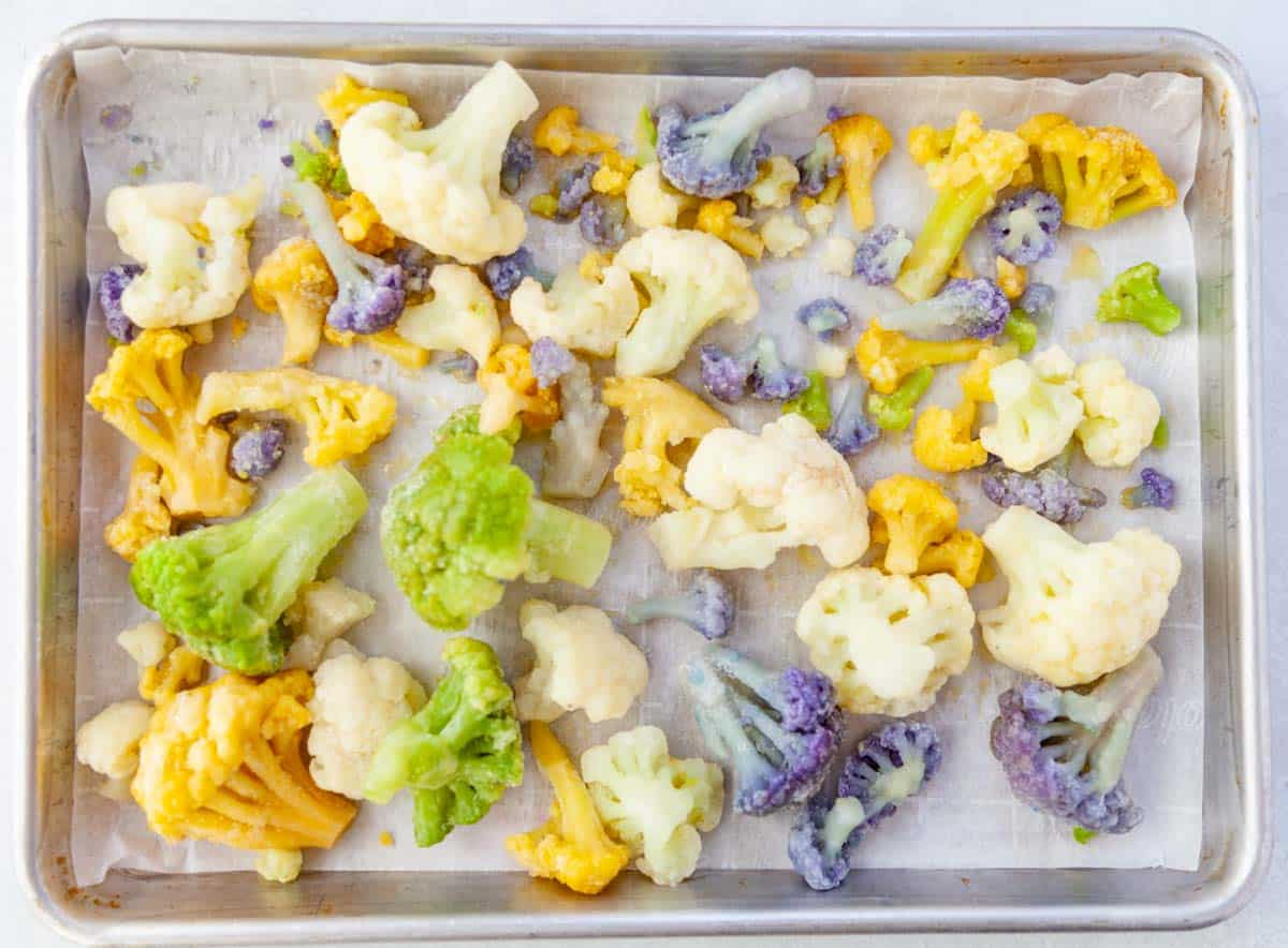 frozen rainbow cauliflower on a sheet pan