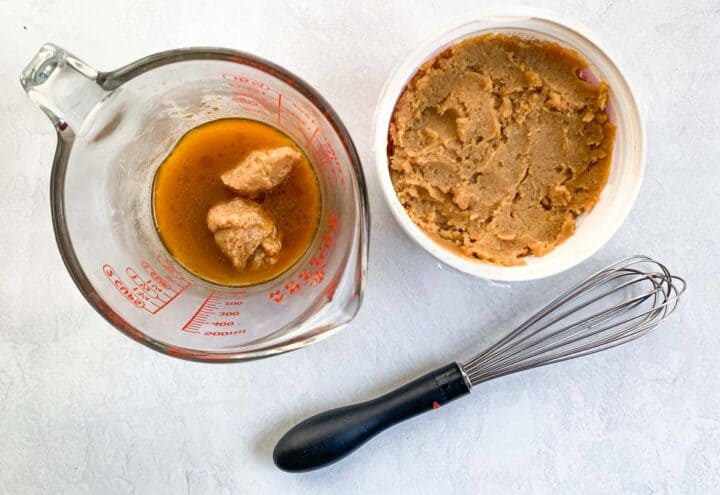 two spoonfuls of miso whisked into broth