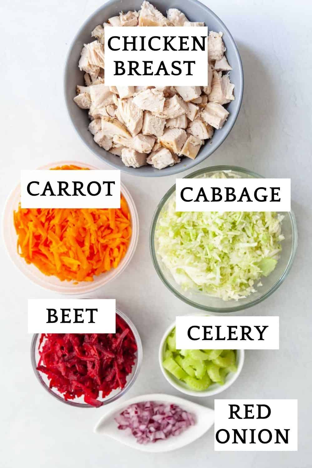 ingredients for veggie chicken salad: chopped chicken breast, cabbage, carrots, beet, red onion